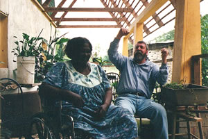 Sambo Mockbee with a beneficiary of a Rural Studio house